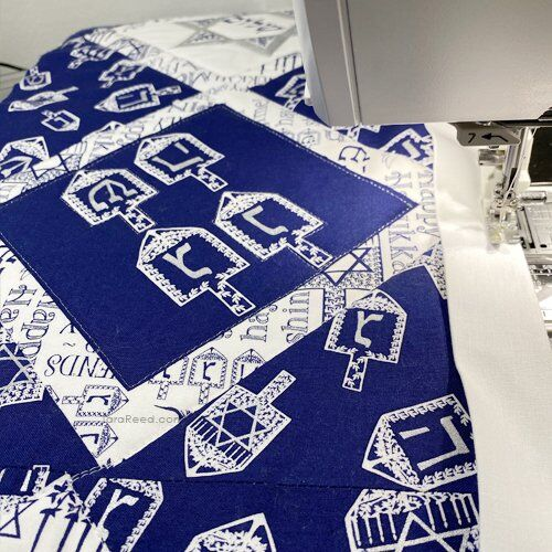 Make a Table Runner for Hanukkah using the Festival of Lights Fabric Panel