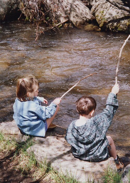 two kids fishing